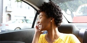 Zimnat woman using phone in car