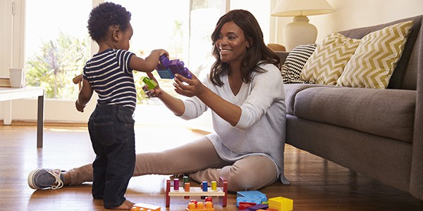 Zimnat woman with baby playing with toys