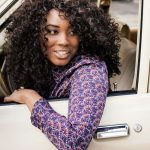 Zimnat young lady sitting in a car