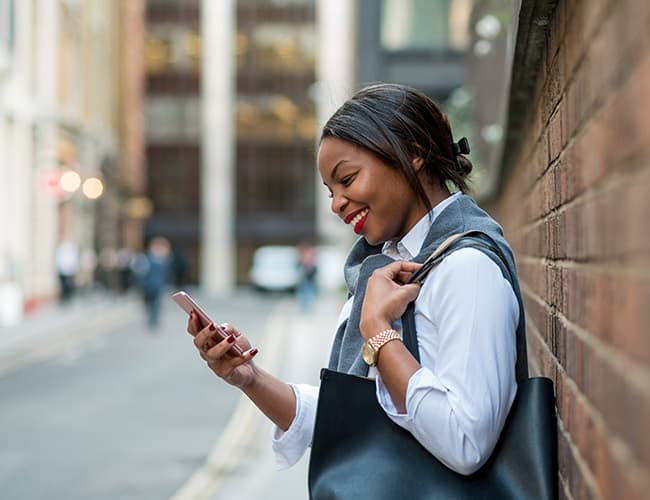 Zimnat young lady using mobile phone