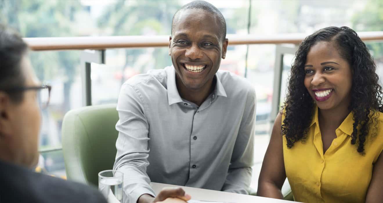 Zimnat black couple sealing a deal